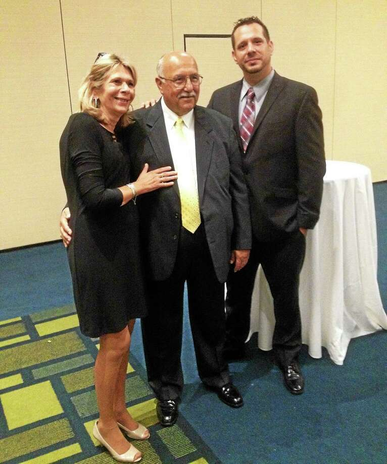 From left are: Sharon Anthony, her husband Cromwell Town Manager Anthony Salvatore, and their son, T.J. Salvatore, at the former chief of police's retirement dinner. Photo: Jeff Mill — The Middletown Press