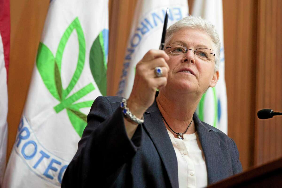 Environmental Protection Agency (EPA) Administrator Gina McCarthy holds up a pen before signing new emission guidelines during an announcement of a plan to cut carbon dioxide emissions from power plants by 30 percent by 2030, Monday, June 2, 2014, at EPA headquarters in Washington. In a sweeping initiative to curb pollutants blamed for global warming, the Obama administration unveiled a plan Monday that cuts carbon dioxide emissions from power plants by nearly a third over the next 15 years, but pushes the deadline for some states to comply until long after President Barack Obama leaves office. (AP Photo/ Evan Vucci)