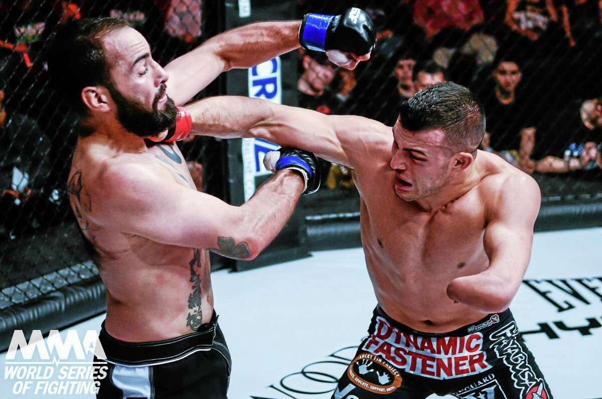 Nick Newell exchanges punches with Joe Condon at WSOF 20. Newell won the fight by a unanimous decision.