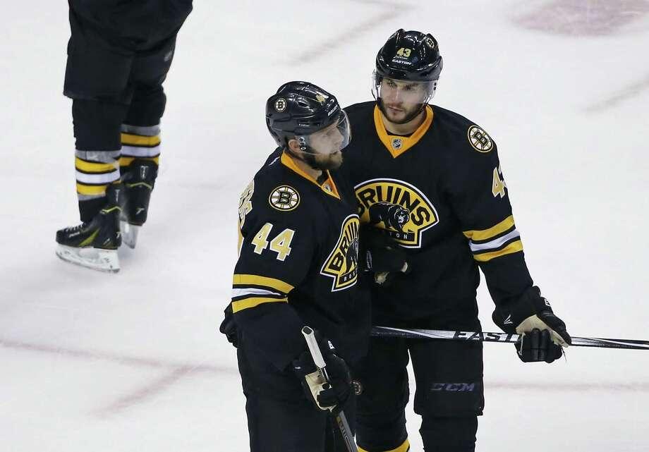 Bruins defensemen Dennis Seidenberg (44) and Matt Bartkowski (43) confer after the game-winning goal by the Avalanche's Daniel Briere on Monday. Photo: Elise Amendola — The Associated Press  / AP