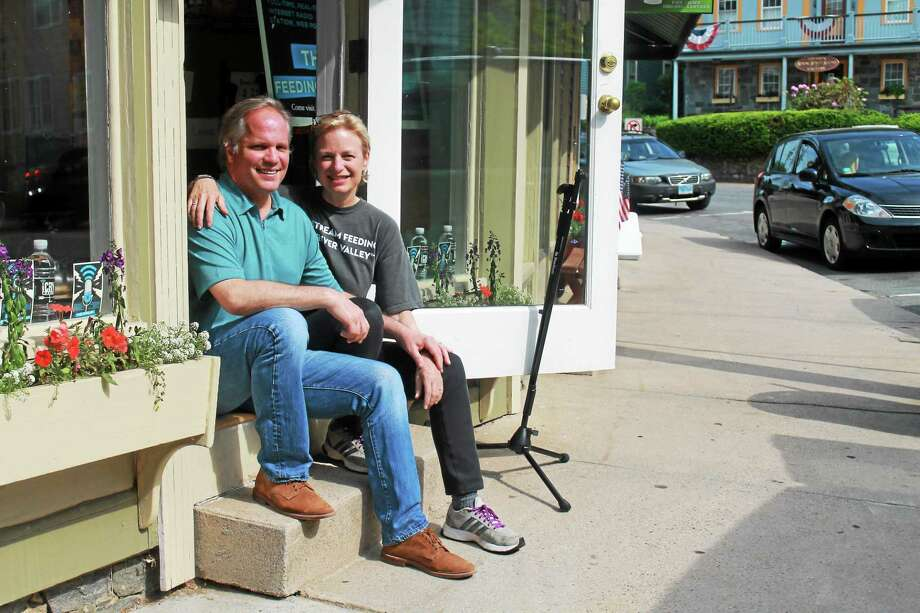Relaxing outside their new radio station studio in Chester are David Williams, general manager, and Ibby Carothers, executive producer of iCRVradio. Both have extensive backgrounds in television, in reporting, producing and sales. Photo: Photos By Valerie Bannister