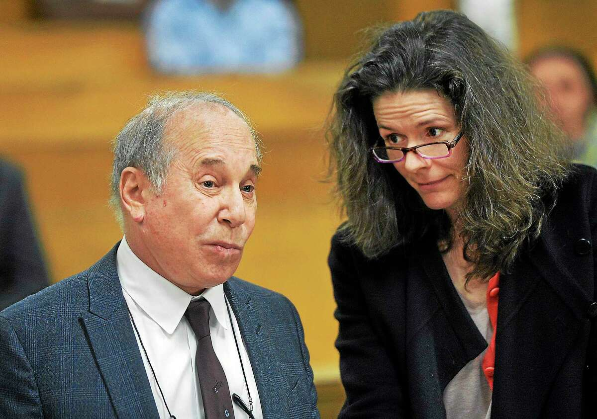 In this April 28, 2014 photo, singer Paul Simon, left, and his wife Edie Brickell appear at a hearing in Norwalk Superior Court in Norwalk, Conn.