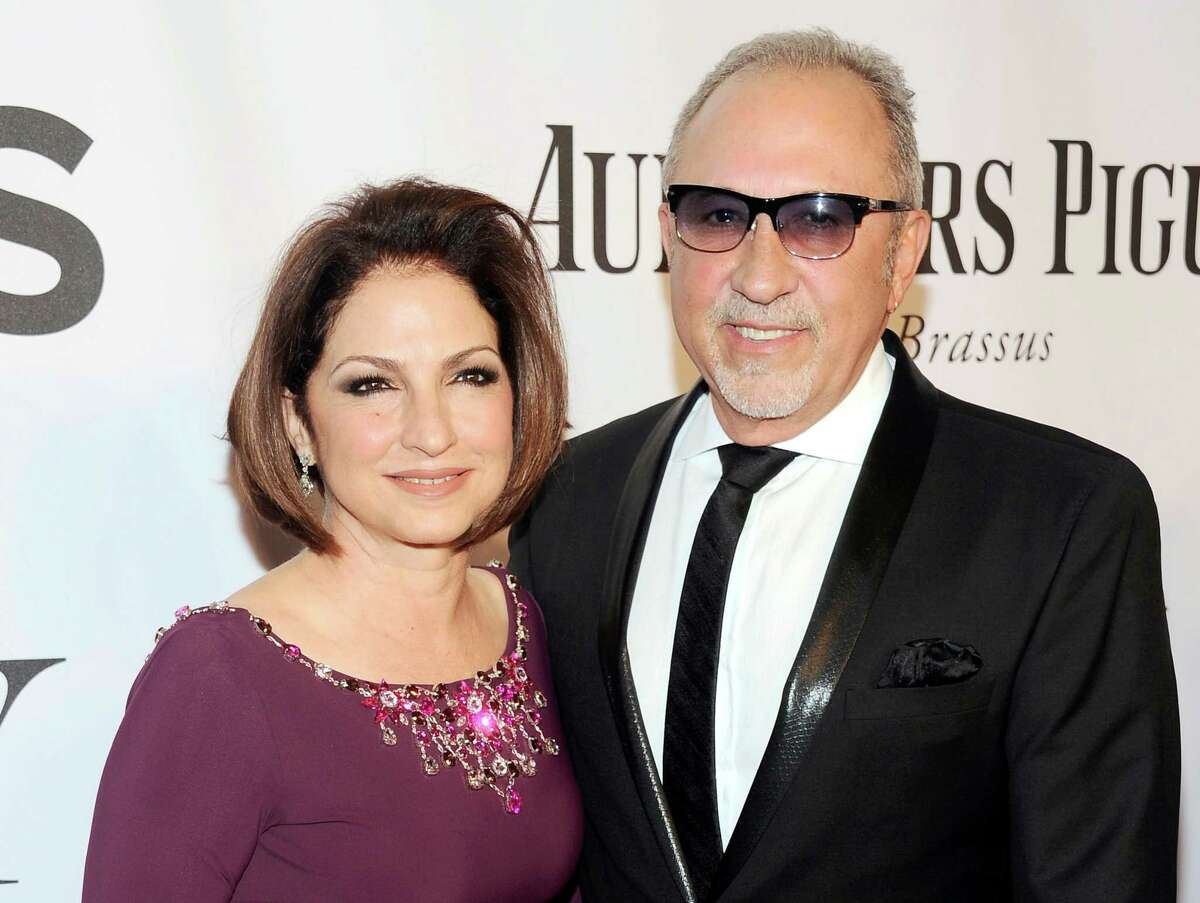 """In this June 8, 2014 photo, Gloria Estefan, left, and Emilio Estefan pose for photos at the 68th annual Tony Awards at Radio City Music Hall in New York. Gloria Estefan and her husband, Emilio, are shepherding their musical biography """"On Your Feet!"""" to Broadway this fall, celebrating two Cuban-Americans who embraced the American Dream and now own enough Grammy Awards to fill a house."""