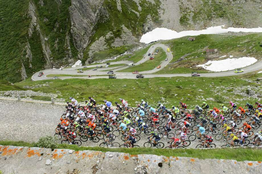"The pack rides the old ""Tremola"" road, a cobblestone section, as the riders climb the Gotthard Pass during the 3rd stage, a 117.3 km race, from Quinto to Olivone, at the 79th Tour de Suisse UCI ProTour cycling race, in the Gotthard Pass, Switzerland on June 15, 2015. Photo: Jean-Christophe Bott/Keystone Via AP  / Keystone"
