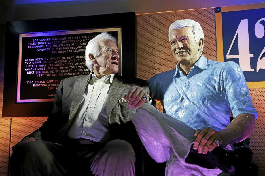 Brewers radio announcer Bob Uecker sits next to his statue at Miller Park in Milwaukee. Photo: Morry Gash — The Associated Press File Photo  / AP