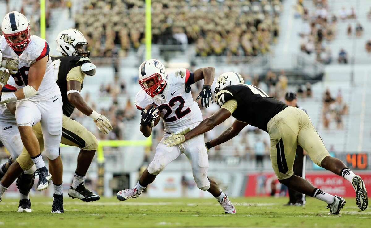 UConn's Arkeel Newsome (22) finished with 257 all-purpose yards in Saturday's win over UCF.