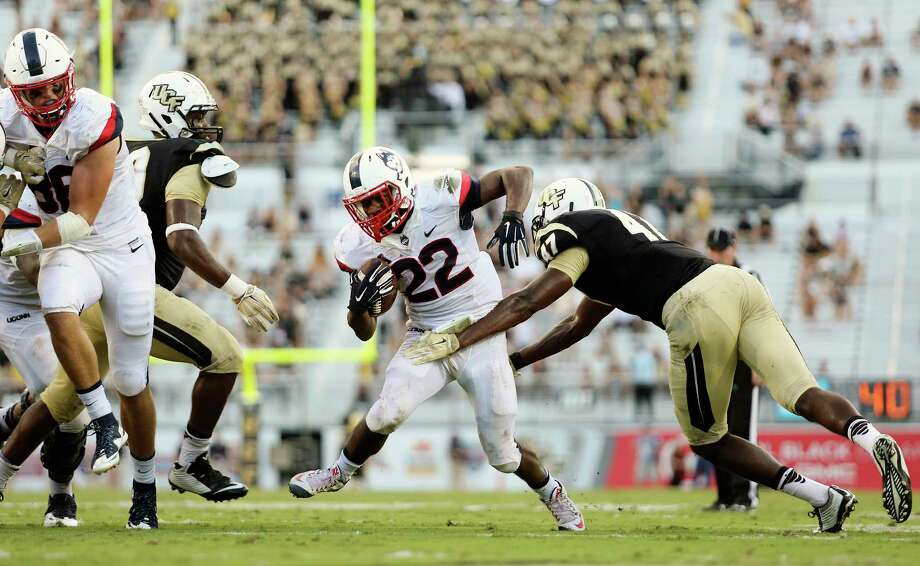 UConn's Arkeel Newsome (22) finished with 257 all-purpose yards in Saturday's win over UCF. Photo: Jacob Langston — Orlando Sentinel Via AP  / Orlando Sentinel