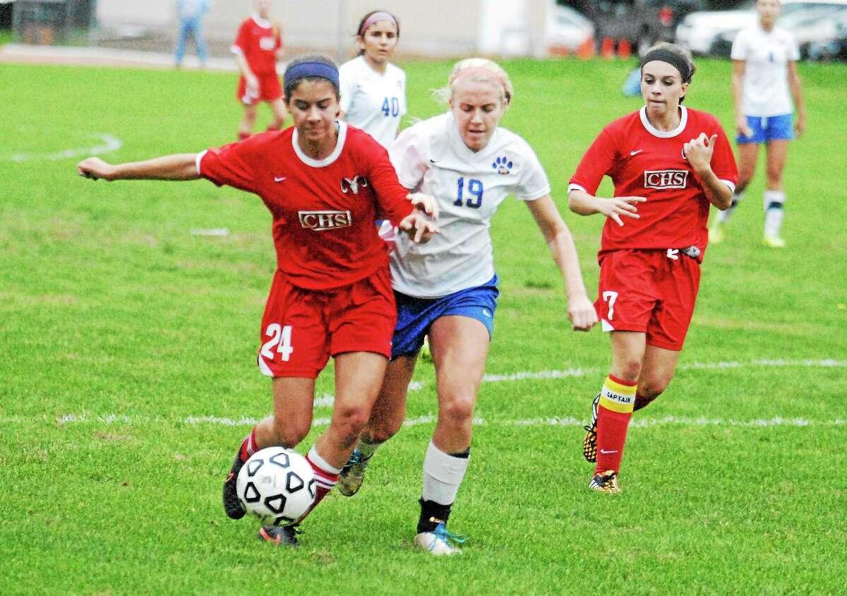 Mercy's Emily Tylki battles for the ball against Cheshire's Saige Bingman as the Rams' Hannah Perez looks on.