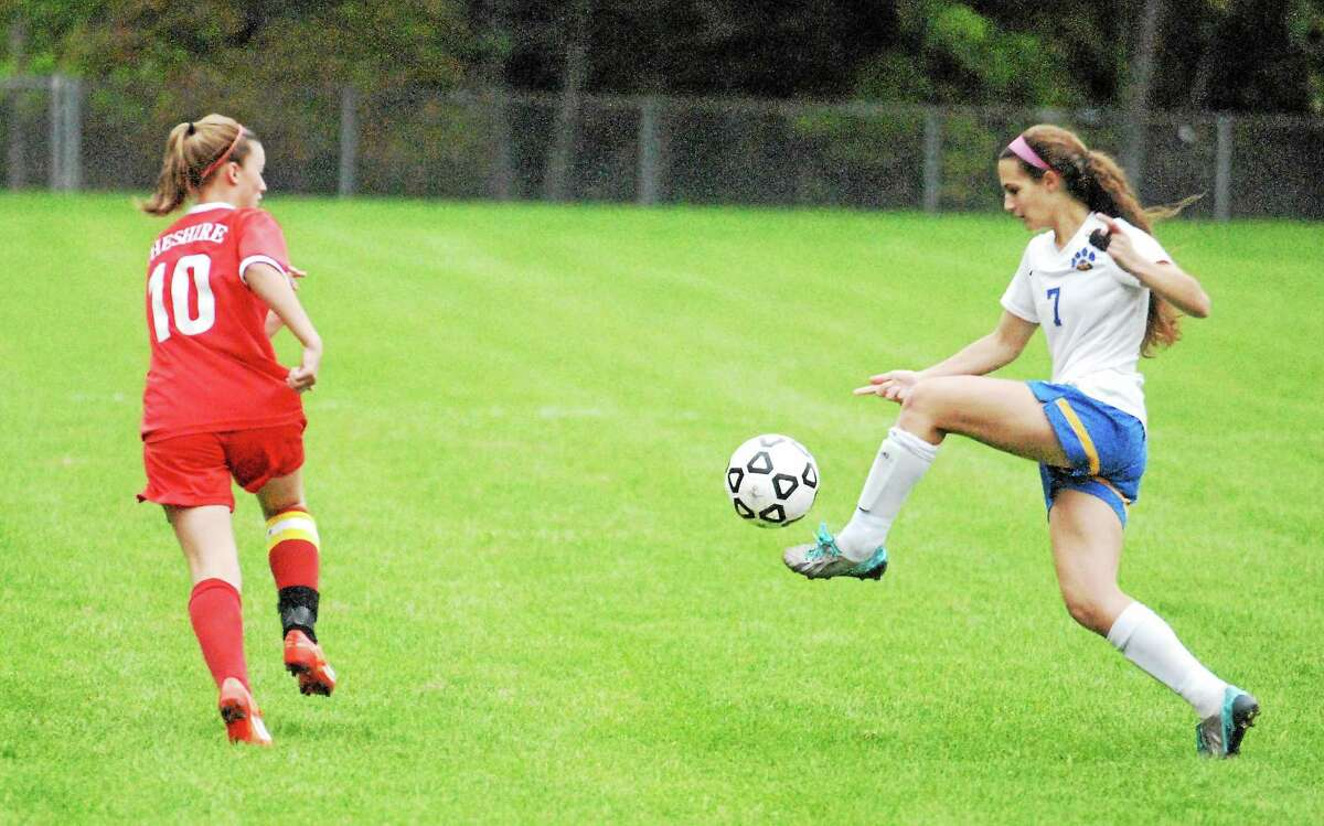 Mercy's Victoria Fiore tries to clear the ball against Cheshire's Kathleen Castrilli on Monday.