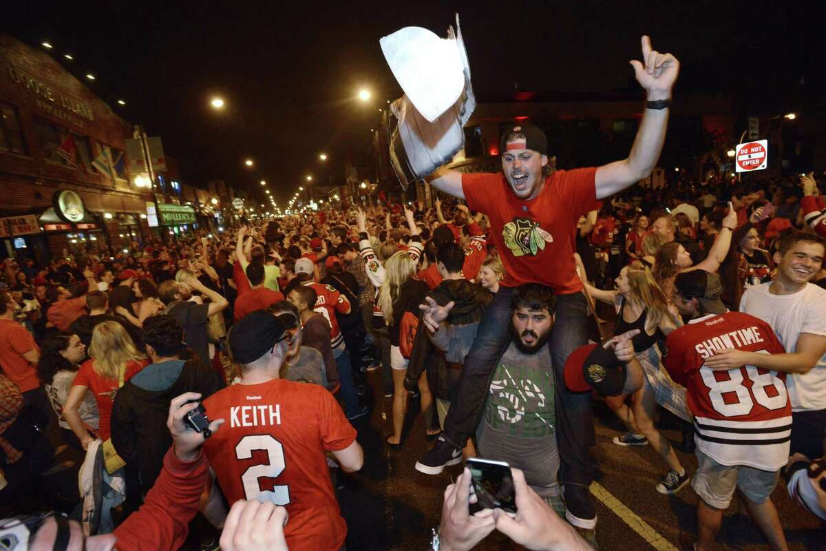 Chicago Blackhawks fans celebrate on Clark Street in the Wrigleyville neighborhood after the Blackhawks won the Stanley Cup Monday against the Tampa Bay Lightning.