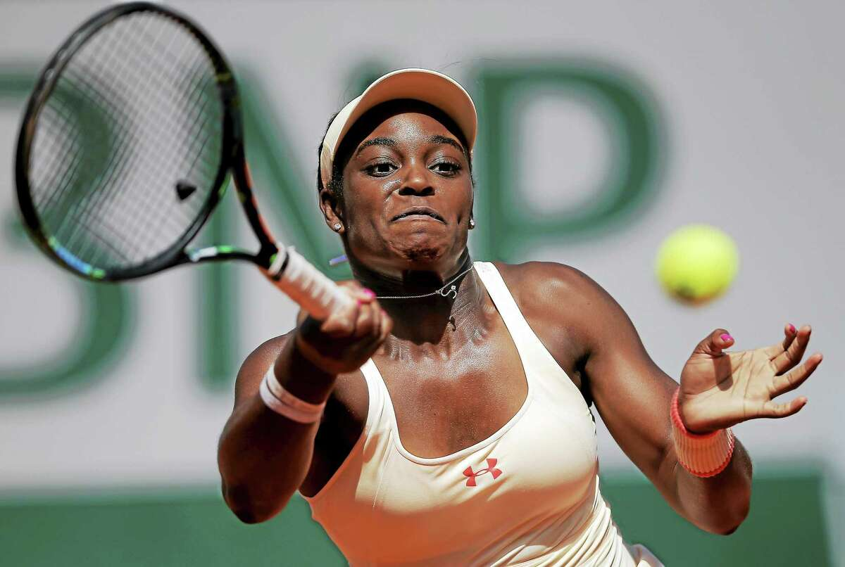 Sloane Stephens returns the ball to Serena Williams during their fourth-round match at the French Open on June 1 in Paris.