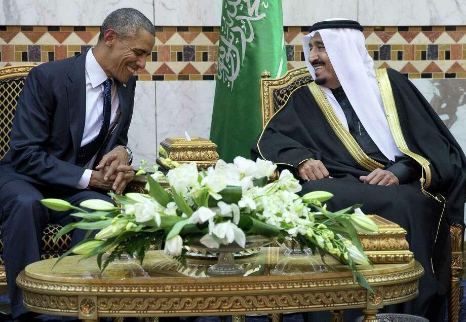 President Barack Obama meets new Saudi Arabian King Salman bin Abdul Aziz in Riyadh, Saudi Arabia, Jan. 27. Photo: Carolyn Kaster — The Associated Press  / AP