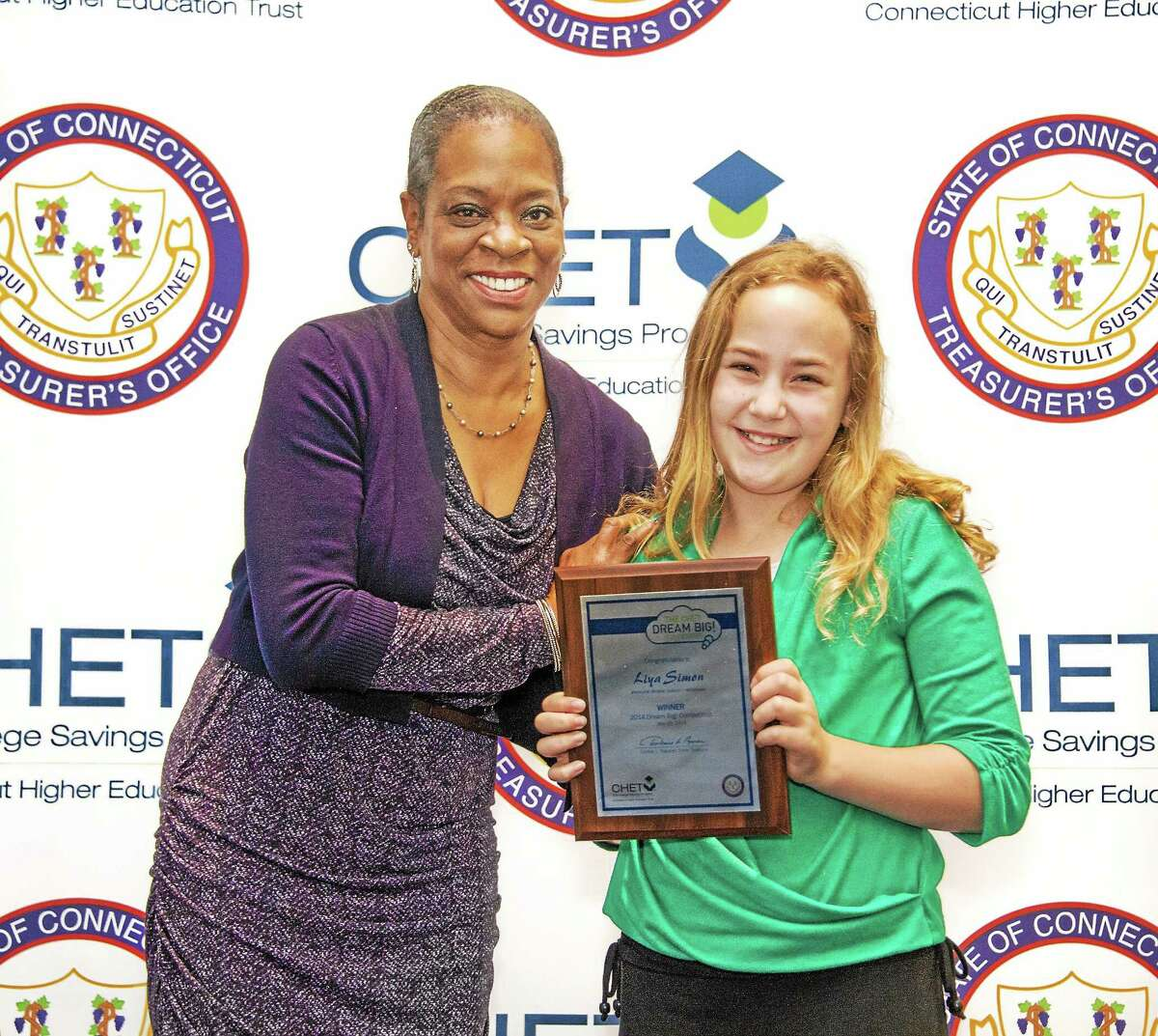 Submitted photo Liya Simon, a fifth grader from Memorial Middle School in Middlefield, was presented one of three grand prizes from the CHET Dream Big! competition by Treasurer Denise Nappier.