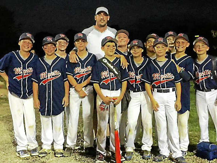 Matt Harvey poses for a picutre with the Mystic Little League 11-12 all-star team this past July Photo: Submitted Photo