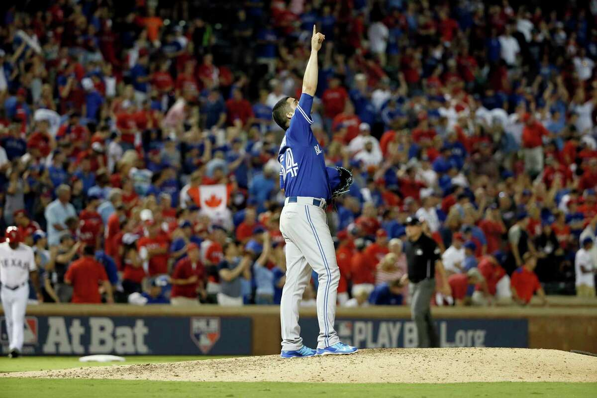 Blue Jays relief pitcher Roberto Osuna celebrates after the Blue Jays 5-1 win against the Rangers in Game 3 Sunday night.