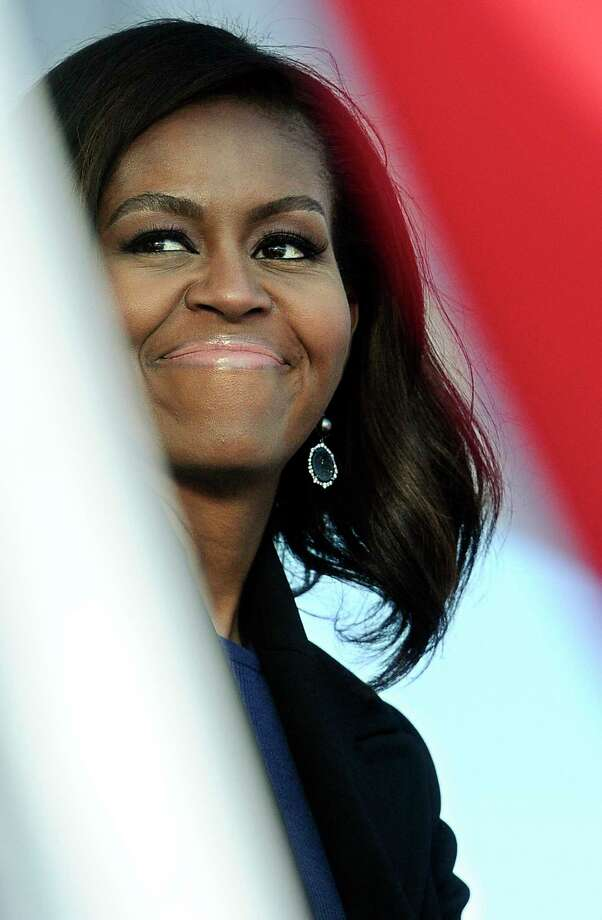 First lady Michelle Obama smiles during christening ceremonies at Electric Boat, a division of General Dynamics, shipyard on Oct. 10, 2015 in Groton, Conn. The $2.7 billion vessel is the 13th in the Virginia class of submarines, which can carry out a range of missions including anti-submarine warfare, delivery of special forces, and surveillance. Photo: AP Photo/Jessica Hill  / AP2015