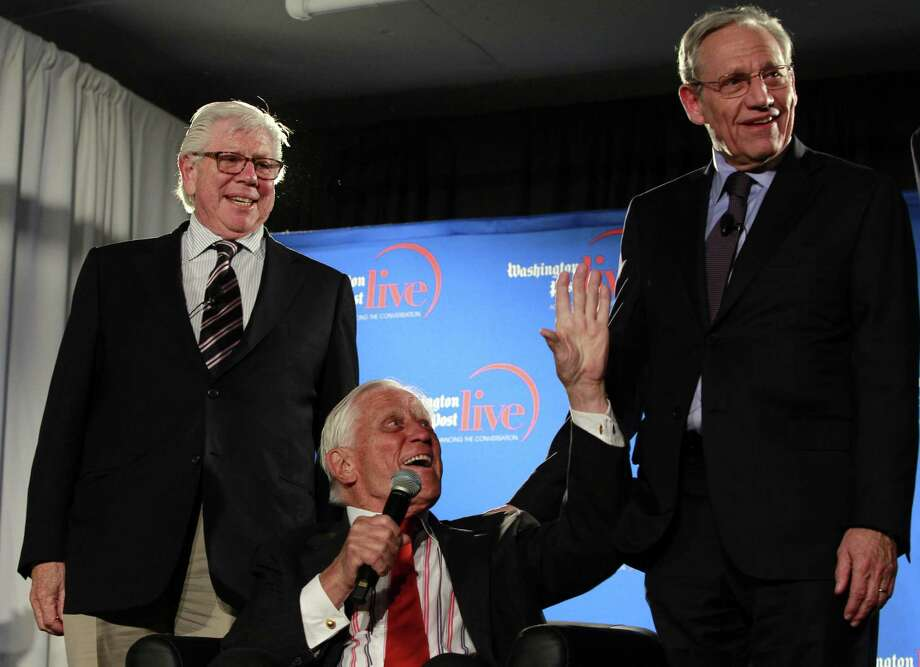 Former Washington Post reporters Carl Bernstein, left, and Bob Woodward, right, stand next to former executive editor Ben Bradlee in this archive photo. Woodward is due to address chamber members next week in Cromwell. Photo: File  / AP