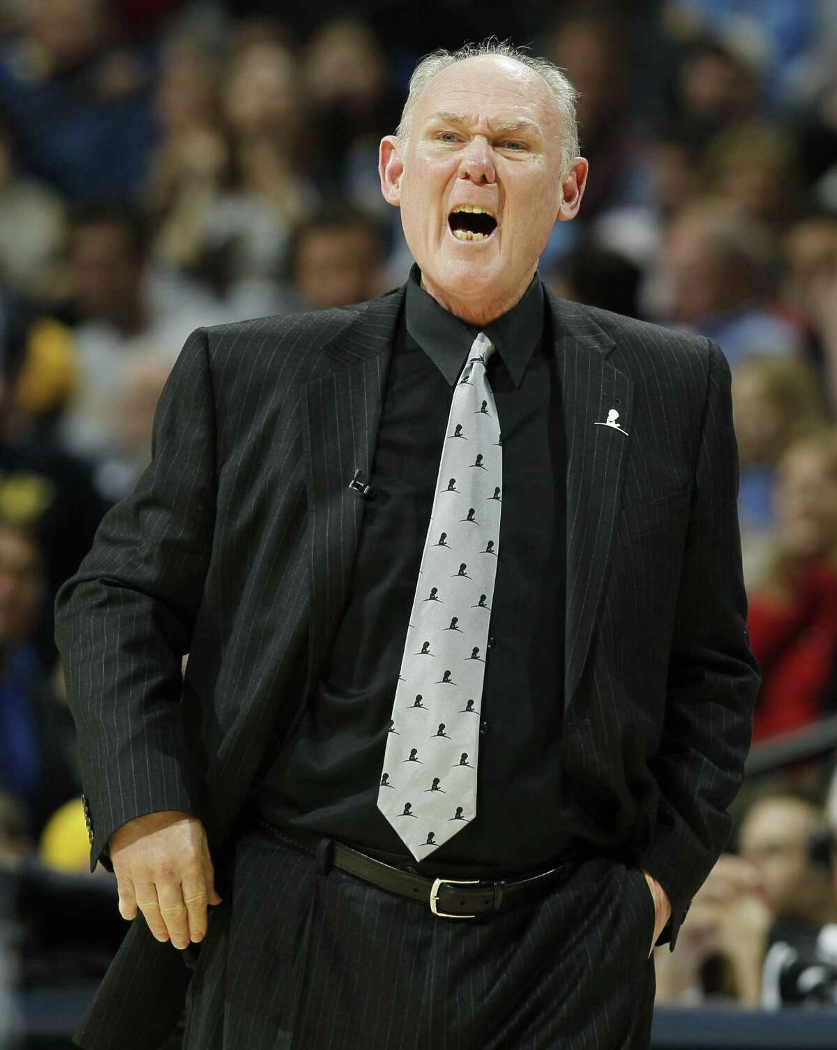 A person familiar with the negotiations says the Sacramento Kings and George Karl have agreed to the framework of a deal for him to take over as coach.