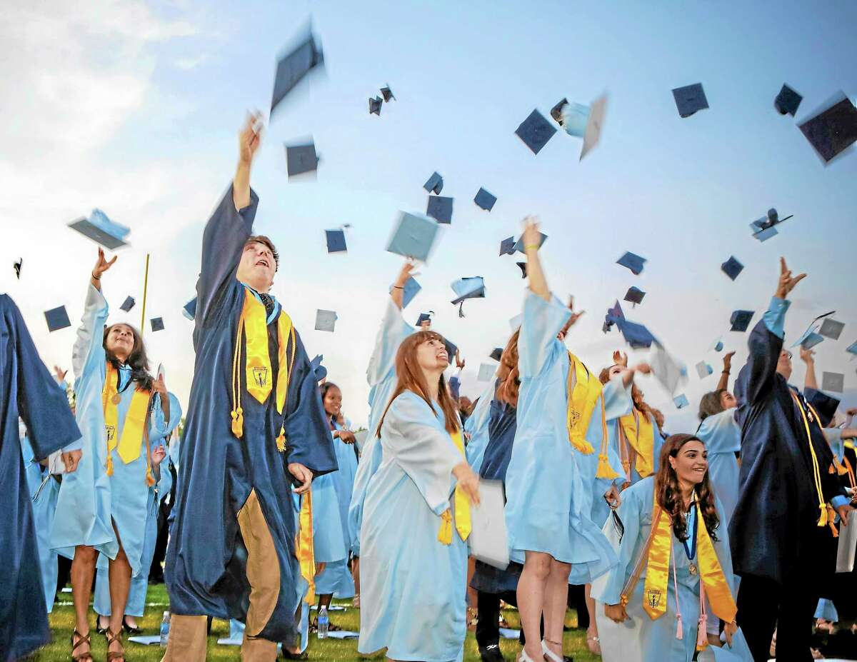 The pinnacle of Middletown High School commencement exercises is the traditional cap toss.
