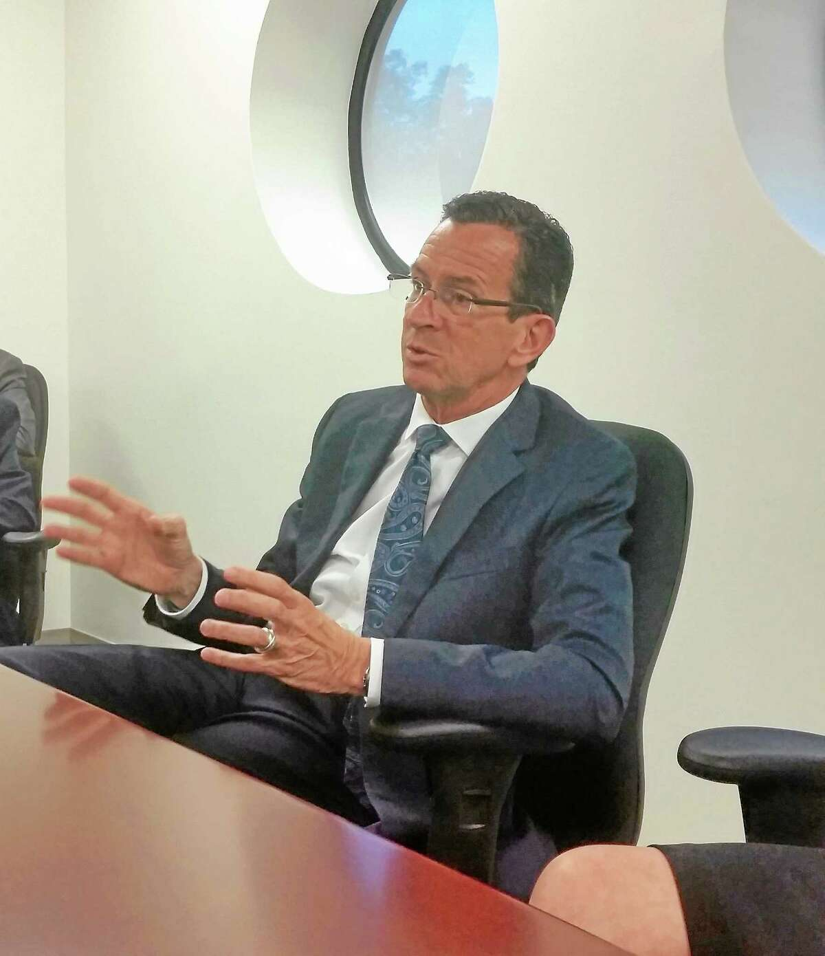 Gov. Dannel Malloy, who is seeking a second term, makes a point during a meeting with the New Haven Register editorial board Monday.