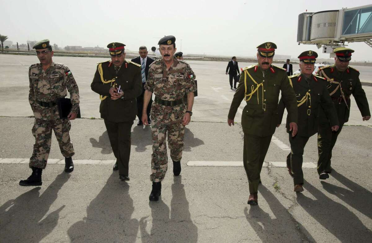 The Chairman of the Joint Chiefs of Staff of the Jordanian armed forces, Lt. Gen. Mashal al-Zaben, center, arrives at the Baghdad Airport in Iraq, Wednesday, Feb. 11, 2015. Al-Zaben met with Iraqi Defense Minister Khalid al-Obeidi and reiterated Jordan's