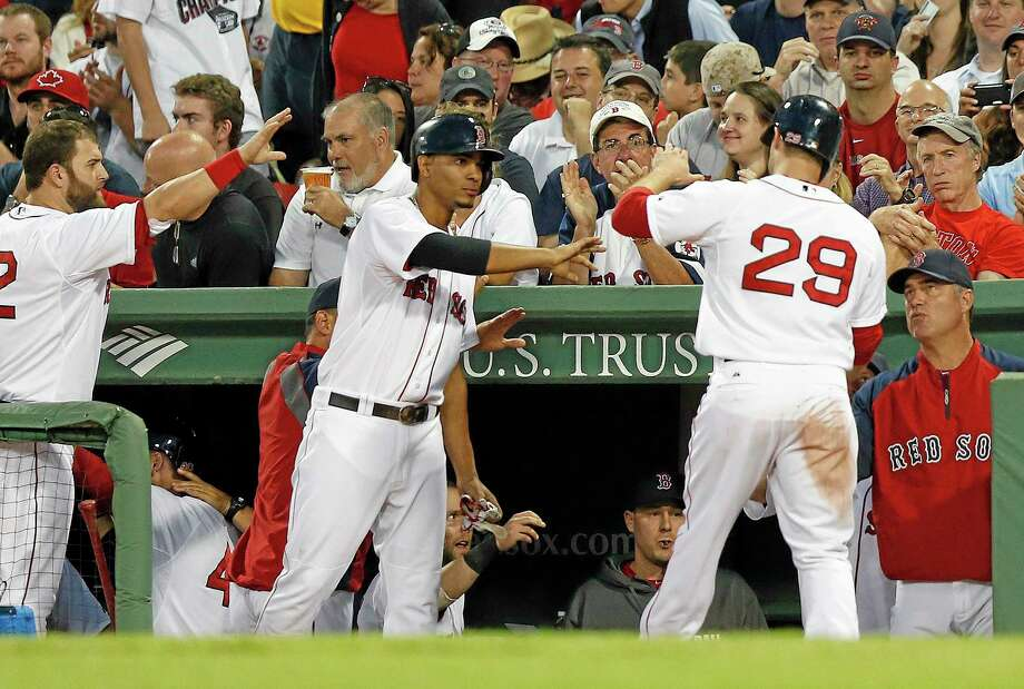 Boston Red Sox's Daniel Nava (29) celebrates after scoring on a sacrifice fly by A.J. Pierzynski during the fifth inning of a baseball game against the Minnesota Twins in Boston, Monday, June 16, 2014. (AP Photo/Michael Dwyer) Photo: AP / AP