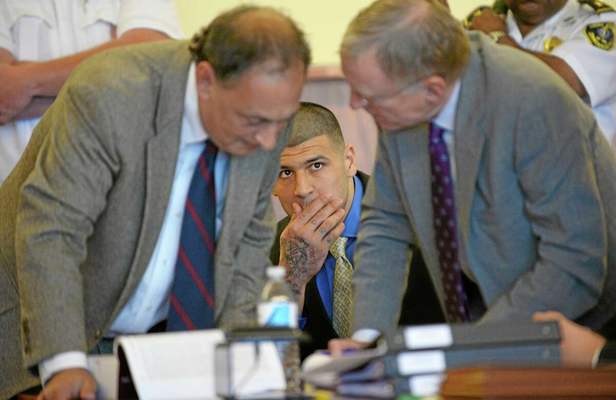 Former New England Patriots NFL football player Aaron Hernandez watches his defense attorneys James Sultan and Charles Rankin during a hearing at the Bristol County Superior Court House, Monday, June 16, 2014, in Fall River, Mass. Hernandez's attorneys challenged the evidence in one of his murder cases, arguing at a pretrial hearing that prosecutors have not established probable cause in the fatal shooting of Odin Lloyd. (AP Photo/Faith Ninivaggi, Pool)
