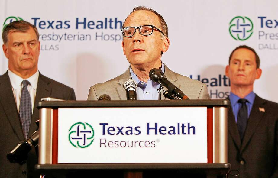 Texas Health Presbyterian Hospital Chief Clinical Officer Dr. Daniel Varga answers questions about a health care worker who provided hospital care for Thomas Eric Duncan who contracted Ebola, during a press conference at the hospital on Oct. 12, 2014, in Dallas. Photo: AP Photo/Brandon Wade  / FR168019 AP