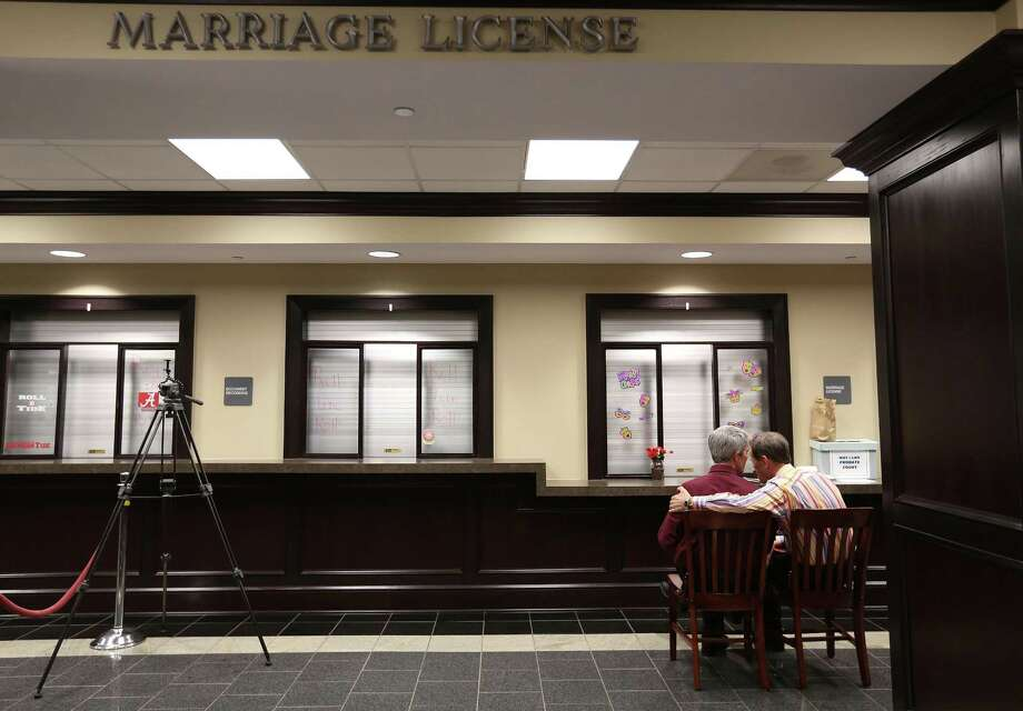 Milton Persinger, left, and Robert Povilat wait for a marriage license at the Mobile County Probate office on Tuesday. Photo: AP Photo  / AL.com