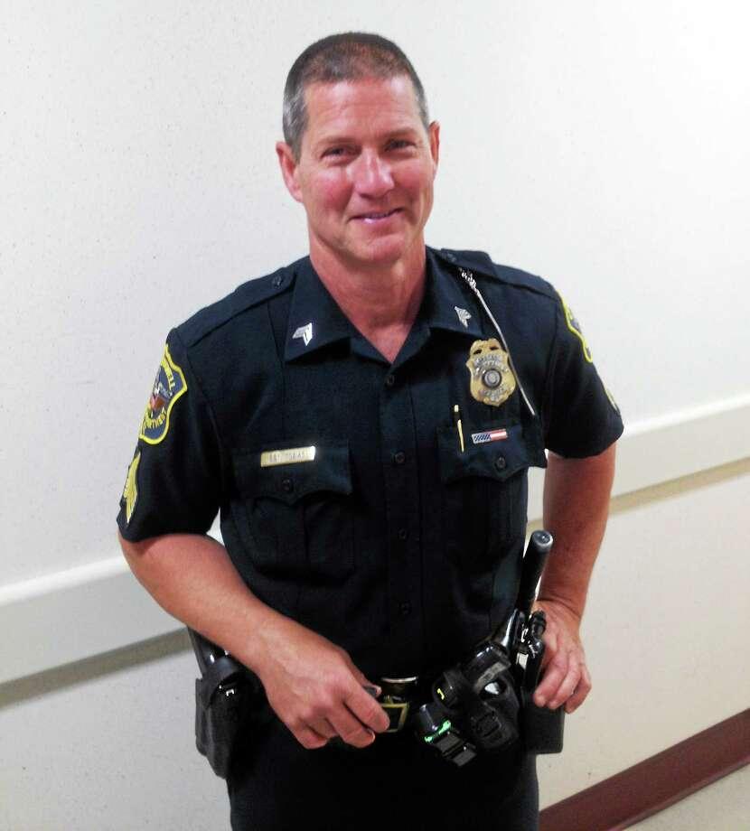 Retiring Sgt. Louis J. Tobias. Photo: Jeff Mill — The Middletown Press