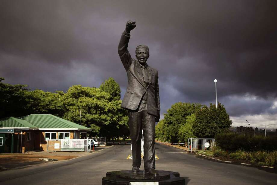 A statue of former South African President Nelson Mandela, with a raised fist, stands outside the former Victor Verster prison, renamed to Drakenstein Correctional center, near the town of Franschhoek, South Africa, Tuesday, Feb. 10, 2015.  On Feb. 11, 1990,  former South African President Nelson Mandela walked free from the Victor Verster prison with his then wife Winnie Madikizela-Mandela, with a raised fist in the air after being jailed for 27 years by the former South African Apartheid Government. Tomorrow marks the 25th anniversary of Mandela's release from prison. (AP Photo/Schalk van Zuydam) Photo: AP / AP