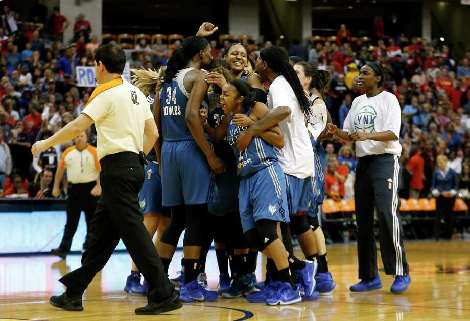 Minnesota Lynx forward Maya Moore celebrates with her teammates after hitting a buzzer-beater in Game 3 of the WNBA Finals on Friday night. Photo: AJ Mast — The Associated Press  / AJ Mast