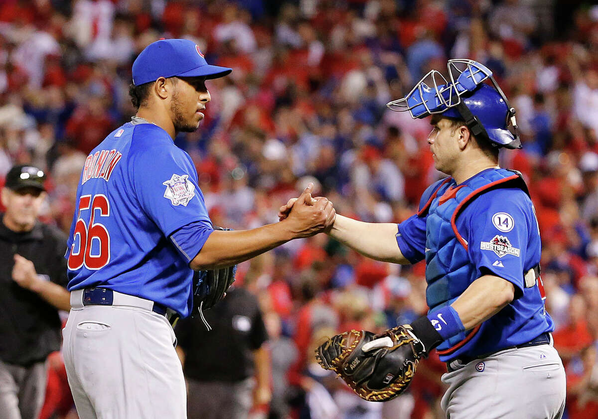 The Cubs' Hector Rondon, left, is congratulated by catcher Miguel Montero after the Cubs defeated the Cardinals in Game 2 of the NLDS on Saturday.