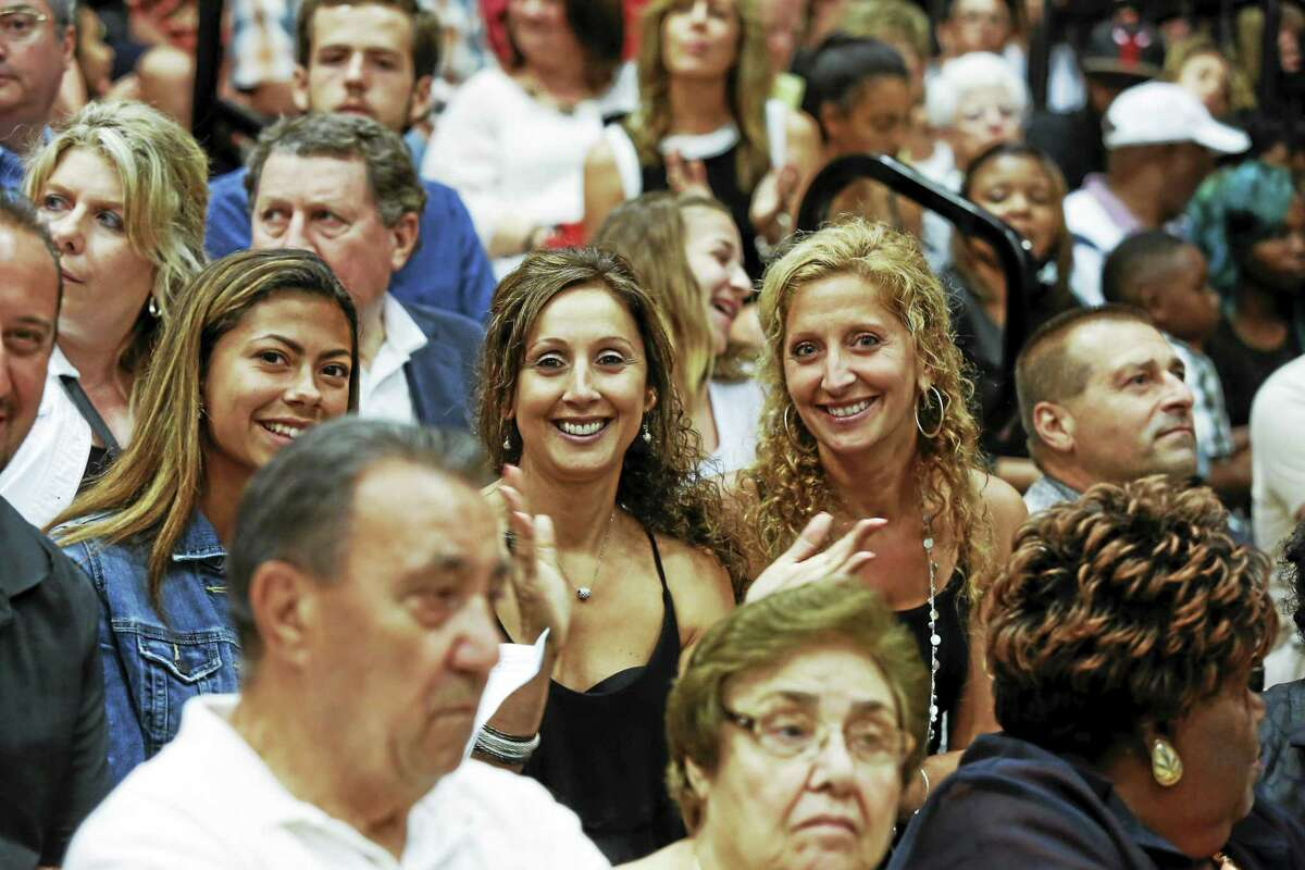Sandy Aldieri - The Middletown Press Middletown High School's Class of 2015 graduation ceremonies were moved indoors on Tuesday June 16 - with family and friends split between the Performing Arts Center auditorium (where exercises were live streamed) and the gymnasium.