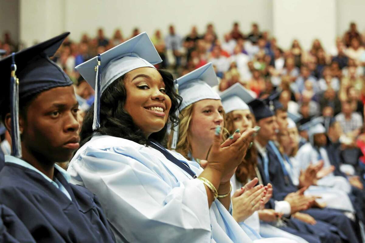 Middletown High School's Class of 2015 graduation ceremonies were moved indoors on Tuesday June 16 — with family and friends split between the Performing Arts Center auditorium (where exercises were live streamed) and the gymnasium.