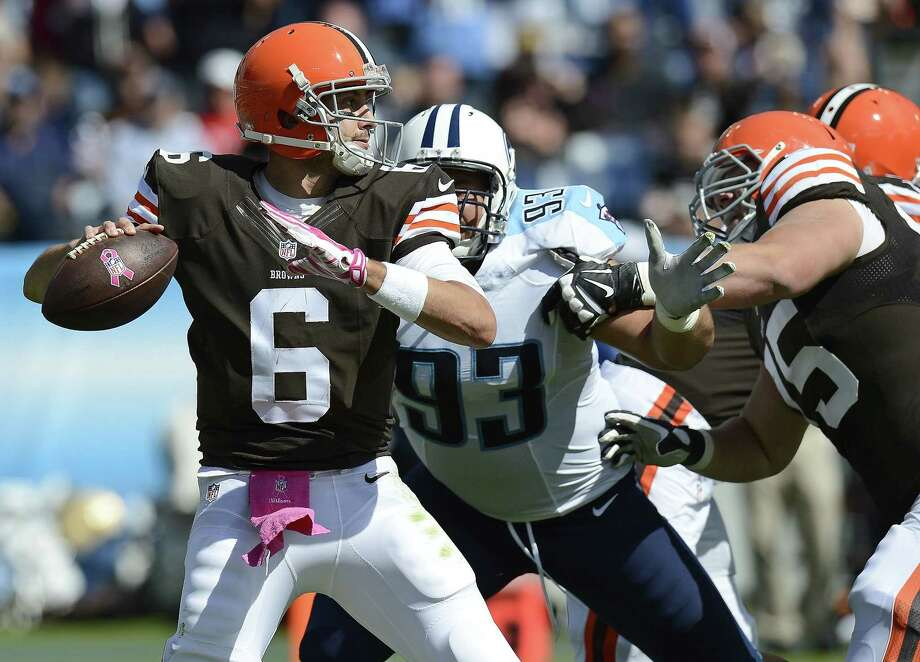 Cleveland Browns quarterback Brian Hoyer (6) passes under pressure from Titans defensive tackle Mike Martin (93) in the second quarter of last Sunday's game in Nashville, Tenn. Photo: Mark Zaleski — The Associated Press  / FR170793 AP