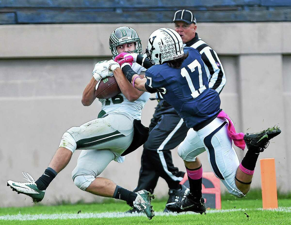 Dartmouth's Bo Patterson hauls in a long touchdown reception in the first quarter as Yale's Lambie Lanman defends. The Big Green beat the Bulldogs 38-31 on Saturday at Yale Bowl.