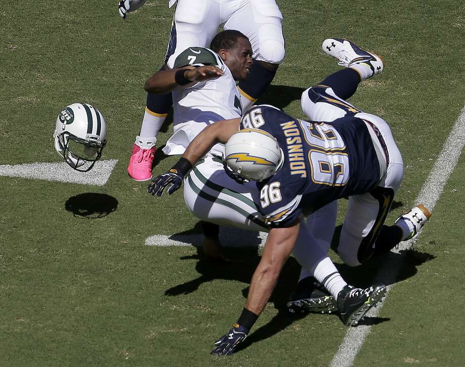Chargers linebacker Jarret Johnson tackles New York Jets quarterback Geno Smith and knocks off his helmet during last Sunday's game in San Diego. Register sports columnist Chip Malafronte points out that subpar coaching, playing and preparedness is all just par for the course for the Jets. Photo: Chris Carlson — The Associated Press  / AP