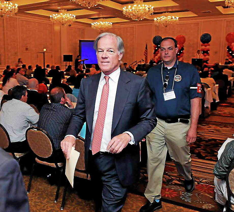 GOP gubernatorial candidate Tom Foley leaves the AFL-CIO political convention at the Omni Hotel in New Haven Monday morning after addressing the union. Photo: Peter Casolino — New Haven Register