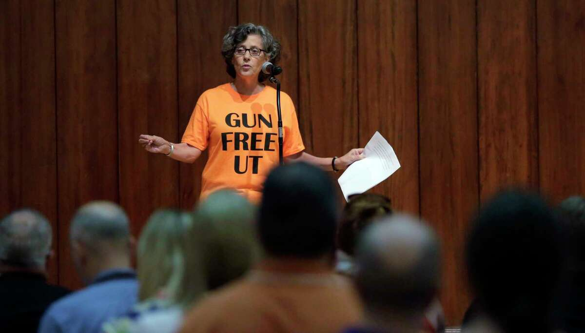 In this Wednesday, Sept. 30, 2015, file photo, professor Joan Neuberger speaks during a public forum as a special committee studies how to implement a new law allowing students with concealed weapons permits to carry firearms into class and other campus buildings, which will take effect in August 2016, in Austin, Texas. Despite a federal law requiring them to have detailed emergency plans, colleges across the country vary widely in how they prepare for campus shootings and inform their staffs and students.