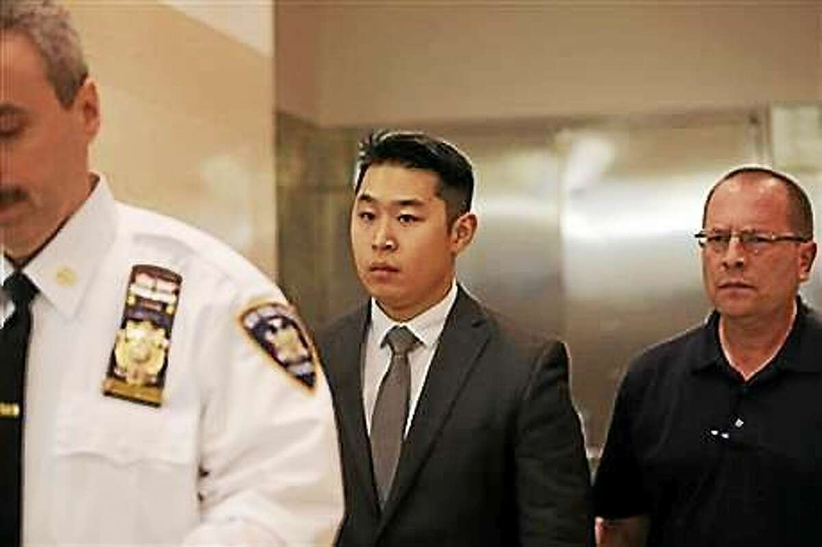 New York City Police Officer Peter Liang leaves court after his arraignment.