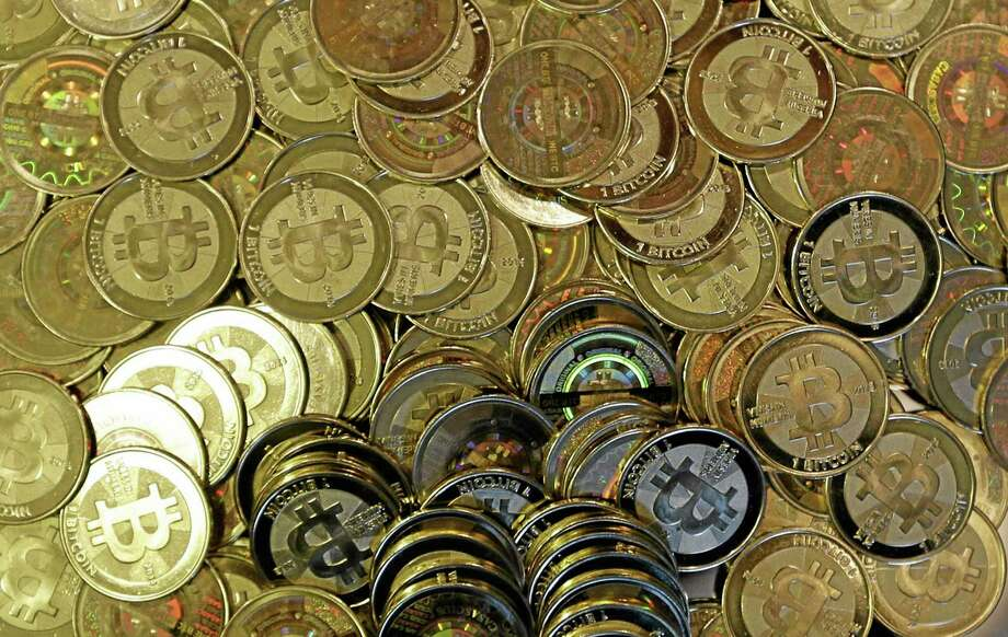 FILE - This April 3, 2013 file photo shows bitcoin tokens in Sandy, Utah.  The website of major bitcoin exchange Mt. Gox is offline Tuesday, Feb. 25, 2014, amid reports it suffered a debilitating theft, a new setback for efforts to gain legitimacy for the virtual currency.  (AP Photo/Rick Bowmer, File) Photo: AP / AP