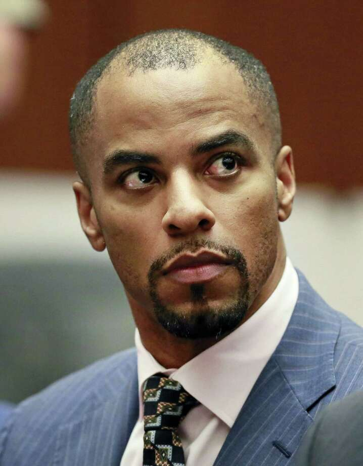 Former NFL player Darren Sharper pleaded guilty to rape Monday in Louisiana state court in New Orleans, completing a series of pleas in four states that will see him serve at least nine years in prison. Photo: Nick Ut — The Associated Press File Photo  / Pool AP