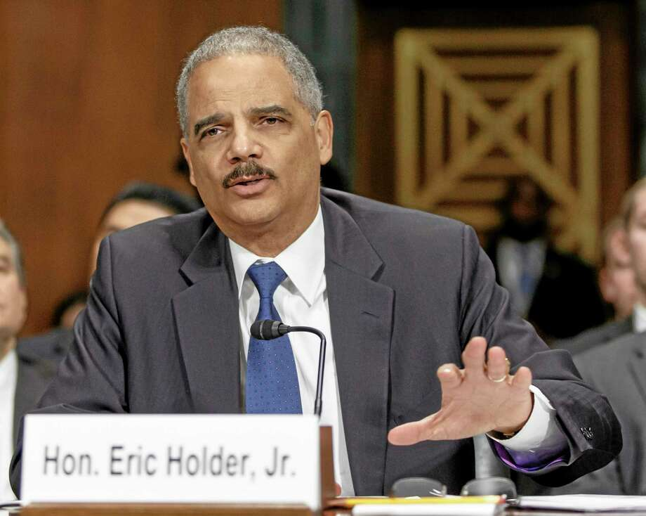 FILE - In this Jan. 29, 2014, file photo, Attorney General Eric Holder testifies on Capitol Hill in Washington. The Justice Department announced Feb. 21, 2014, it is revising its rules for obtaining records from the news media in leak investigations, promising that in most instances the government will notify news organizations beforehand of its intention to do so. The revised procedures are designed to give news organizations an opportunity to challenge any subpoenas or search warrants in federal court.  (AP Photo/J. Scott Applewhite, File) Photo: AP / AP