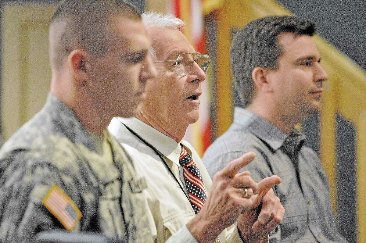 Portland resident Retired Army Lt. Col. Reg Farrington, center, speaks to high school sophomores in the social studies class at the Portland High School Veterans Day program in this file photo.