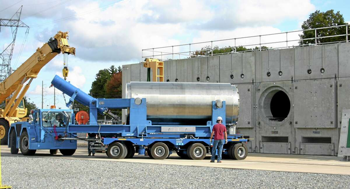 In this Oct. 14, 2010, photo released by Dominion Resources, a trailer holding a spent fuel storage container is maneuvered into position for offloading into a horizontal storage module at the Millstone Power Station in Waterford, Connecticut. With the collapse of a proposal for nuclear waste storage at Nevada's Yucca Mountain, Millstone and other plants across the country are building or expanding on-site storage for waste.