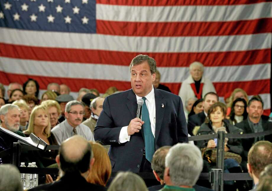 New Jersey Gov. Chris Christie addresses a gathering at a town hall meeting Wednesday, Feb. 26, 2014, in Long Hill, N.J. Christie devoted a portion of Tuesday's budget speech to the state's mounting retiree and debt costs, which are crowding out spending for other programs and services. On Wednesday, Christie took another step at a town hall in Republican-dominated Morris County, by saying he was determined not to allow the state to be hamstrung by these costs.  (AP Photo/Mel Evans) Photo: AP / AP