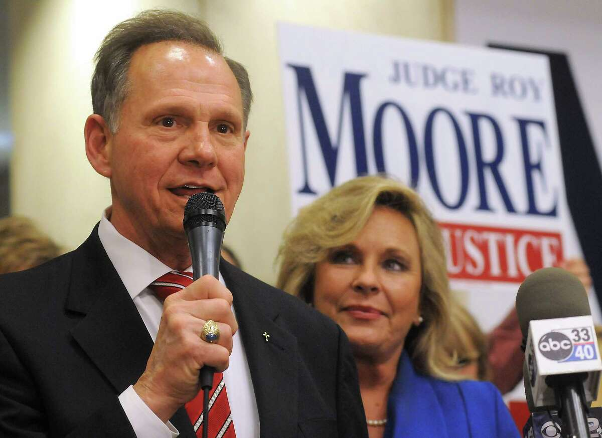 Roy Moore speaks to the audience as wife Kayla looks on at his election party in Montgomery, Ala., in this Nov. 6, 2012, file photo.