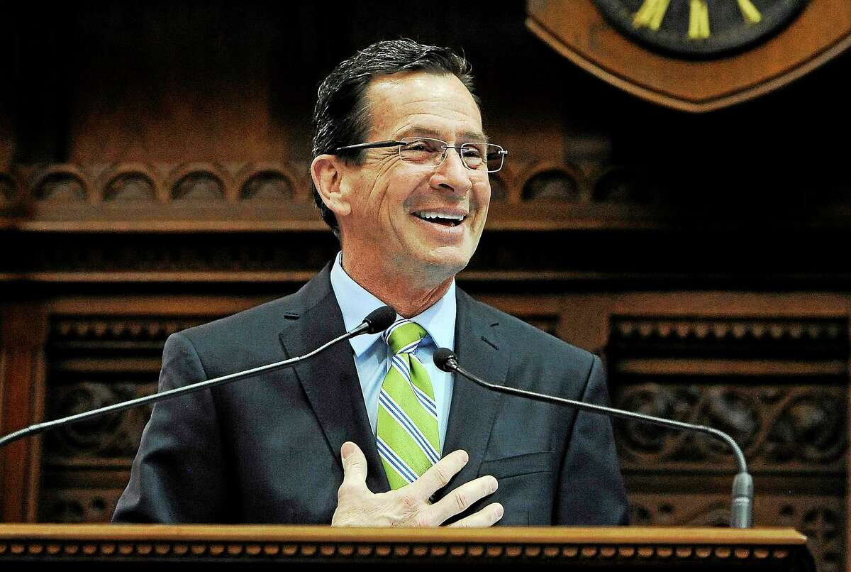 Connecticut Gov. Dannel P. Malloy addresses the House and the Senate at the end of session at the Capitol on the final day of session on May 8, 2014, in Hartford, Conn.