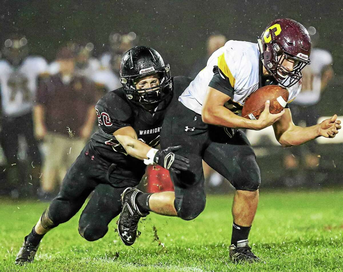 Valley Regional linebacker Cory Bartlett tackles Granby's Gage Fiorentino during Valley's loss to Granby Friday evening.